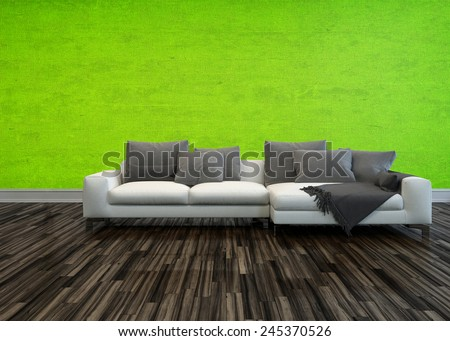 3D Rendering of Single large white sofa with grey cushions standing on a bare wooden parquet floor against a bright green living room wall - stock photo