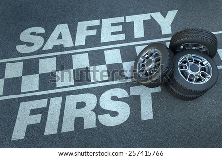 3D rendering of wheels on top of a race circuit with the words safety first - stock photo