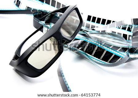 3D shutter glasses on film strip, 3-d experience - stock photo