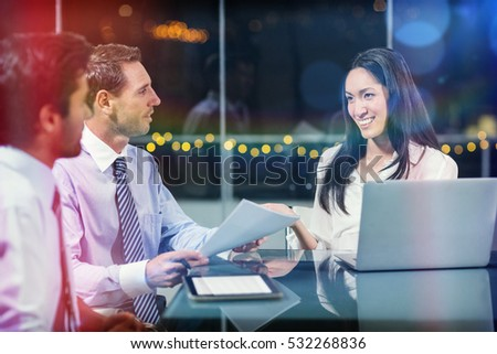 3D Smiling businesswoman discussing with colleagues in office