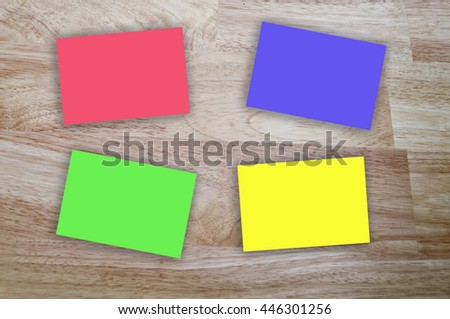 3D sticky note paper on wood table, soft focus