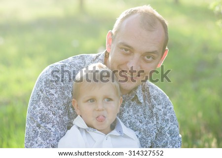 Dad and son in a park on the nature