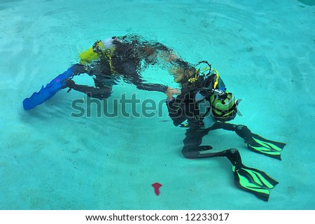'Dancing' divers on bottom. Shot in training pool, Sodwana Bay, KwaZulu-Natal province, Southern Mozambique area, South Africa. - stock photo
