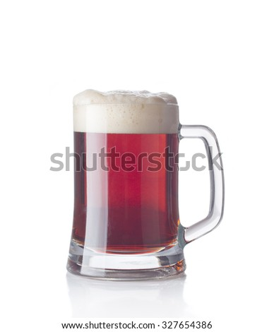 Dark beer glass with froth isolated on a white background - stock photo