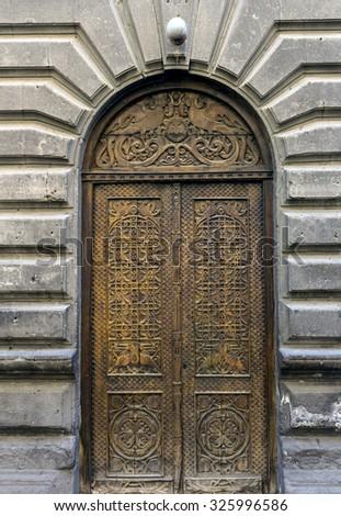 Dark wooden door - stock photo