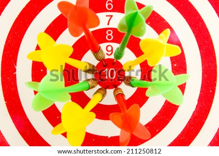 2 dart green and yellow color right on target isolated on white background - stock photo