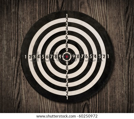 Dartboard hanging on a wooden wall, clipping path.