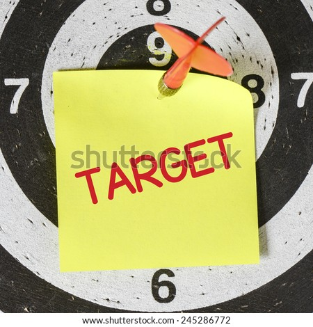 Darts arrow with target. Darts arrow with yellow sticky note with target pined on target center - stock photo