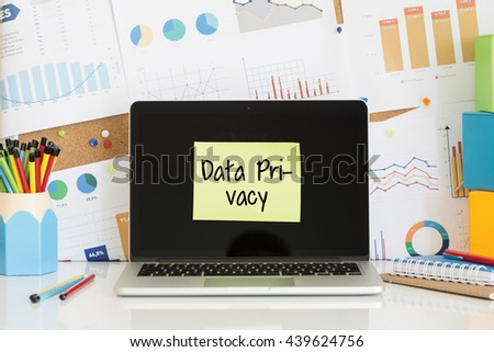 DATA PRIVACY sticky note pasted on the laptop screen - stock photo