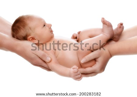 5 days old baby in parents hands - stock photo