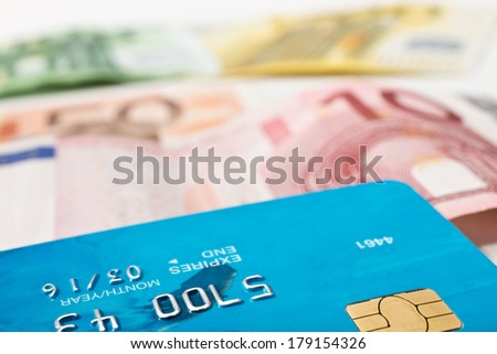 debit card and euro bills