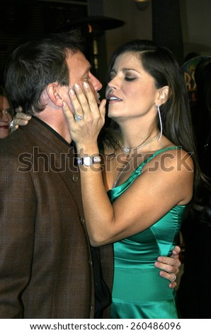 16 December 2004 - Hollywood, California - Glenn Stearns and Mindy Burbano-Stearns. The premiere of 'Meet The Fockers' at the Universal Amphitheatre Universal Studios in Hollywood.  - stock photo