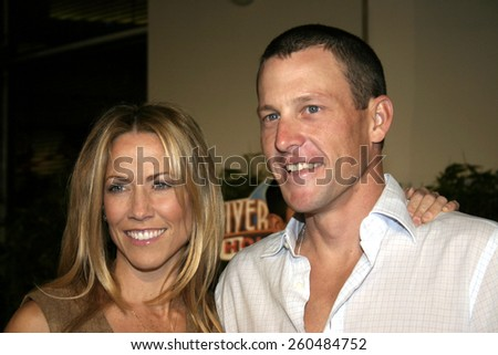 16 December 2004 - Hollywood, California - Lance Armstrong and Sheryl Crow. The premiere of 'Meet The Fockers' at the Universal Amphitheatre Universal Studios in Hollywood.  - stock photo