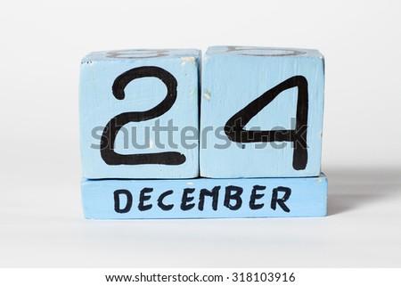 24 december, wooden calendar - stock photo
