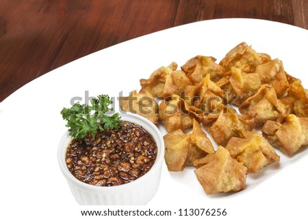 Deep fried shrimp dumplings with sweet and spicy sauce a white plate. - stock photo