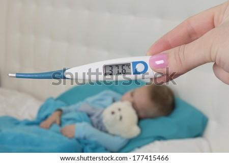 37.6 degrees body temperature on a thermometer for Celso - stock photo