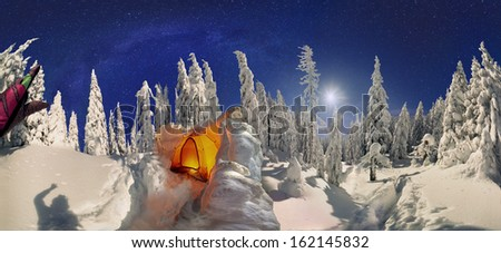 360 degrees panoramic view of wild forest in the mountains of Ukrainian Carpathians, in the village of Osmoloda. Blizzard rolled in a very deep layer of snow Tent nestled protective wall of snow - stock photo