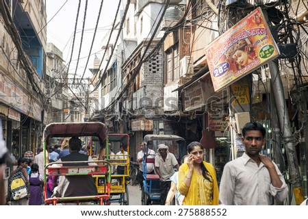 DELHI, INDIA - APRIL  18, 2015  : Busy Indian Street Market on April 18, 2015 in  Delhi, India. - stock photo