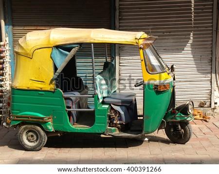 DELHI, INDIA - NOVEMBER 5: Famous Indian transportation  tuk-tuk on November 5, 2014 in Delhi, India. Autorickshaws are very popular means of public transportation in Delhi. - stock photo