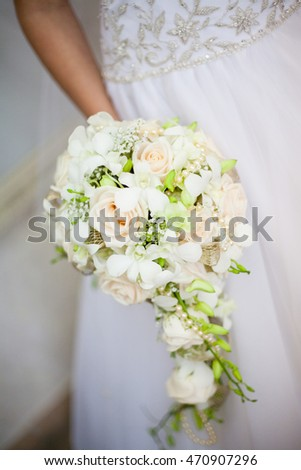 delicate bouquet in hands of the bride
