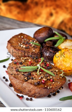delicious grilled steak with vegetable on wooden table - stock photo