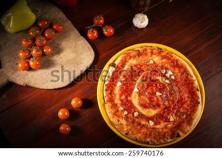Delicious pizza marinara with garlic - stock photo