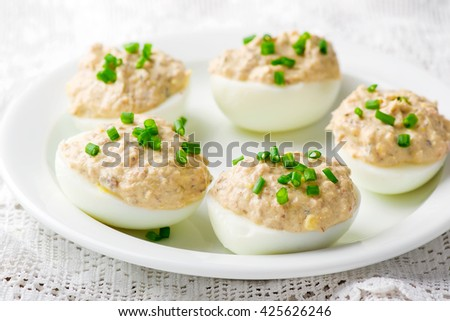 delicious stuffed eggs on white plate. selective focus - stock photo