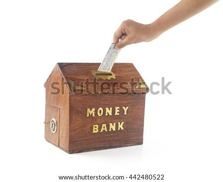 Depositing money in Money Box  - stock photo