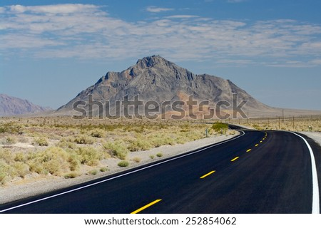 Desert road in the Mojave Desert in California, USA. - stock photo