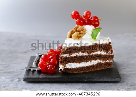 dessert piece of cake with cream and berries  - stock photo