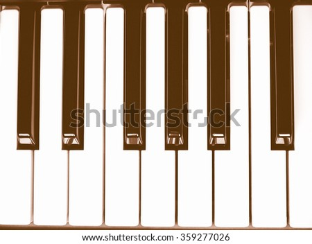Detail of black and white keys on music keyboard vintage - stock photo