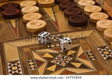 2 dice on the backgammon desk - stock photo