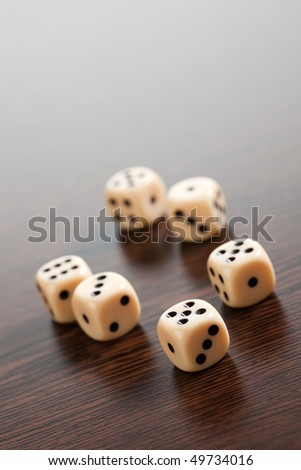 dice on wooden table - stock photo