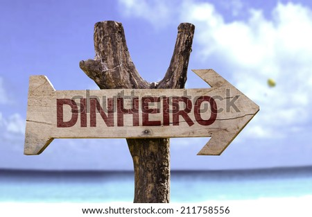 """""""Dinheiro"""" (In portuguese: Money) sign with a beach on background  - stock photo"""