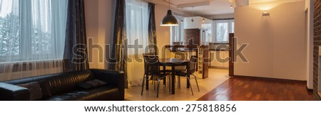 Dining room connected with kitchen in elegant style - stock photo