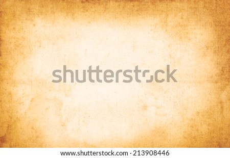 Dirty old scratched parchment with jagged edges  - stock photo
