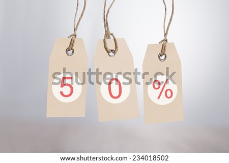 50% discount tags hanging over gray background - stock photo