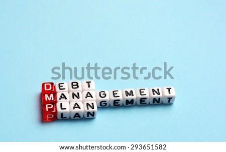 DMP Debt Management Plan written on cubes on blue background - stock photo