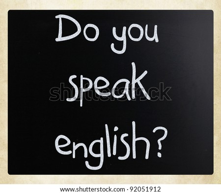 """Do you speak english"" handwritten with white chalk on a blackboard - stock photo"