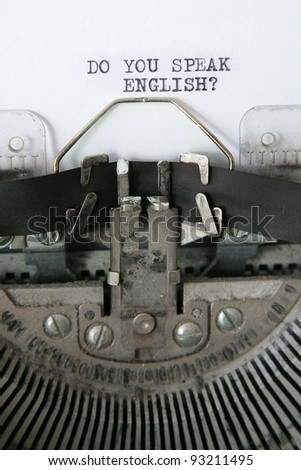 'do you speak English' written on an old typewriter, detail vertical photo. - stock photo