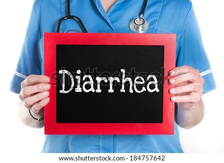 Doctor shows information on blackboard: diarrhea - stock photo