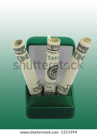 Dollar banknotes in a gift box