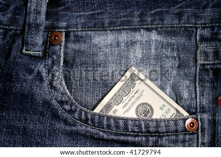 100 dollar bill sticking out from a blue jean pocket - stock photo