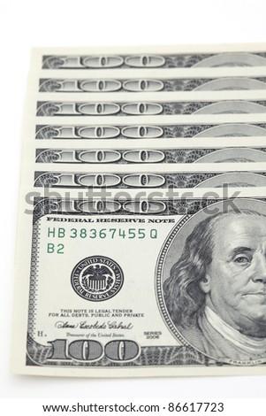 100 dollar bills on white background - stock photo