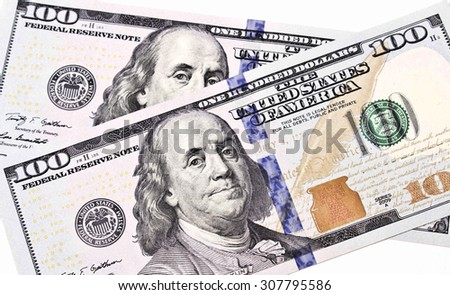 100 dollar bills with Benjamin Franklin's face - stock photo