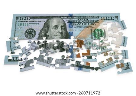 100 dollar puzzle isolated on white background - stock photo