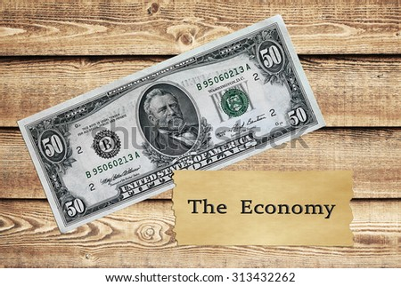 50 dollars bill over wooden background - stock photo
