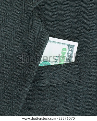 100 dollars, peeking out from the pocket of coat - stock photo