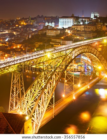 Dom Luis I bridge at night. Old Town of Porto on the background. Portugal
