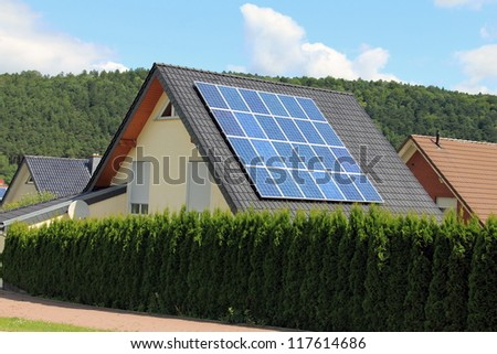 Domestic solar panels allow the production of clean energy - stock photo